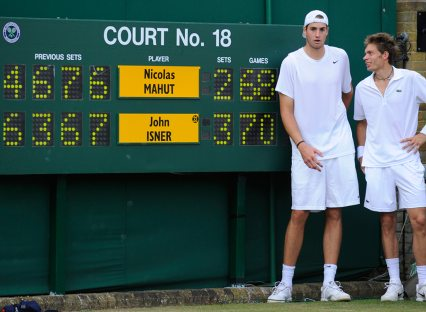 John Isner and Nicolas Mahut at the end of their epic fifth set
